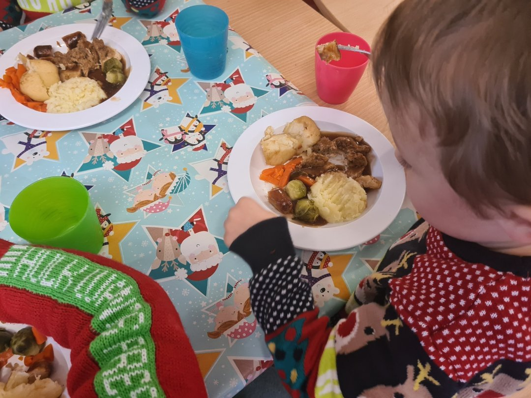 Children at The Old Station Nursery enjoying Christmas dinner