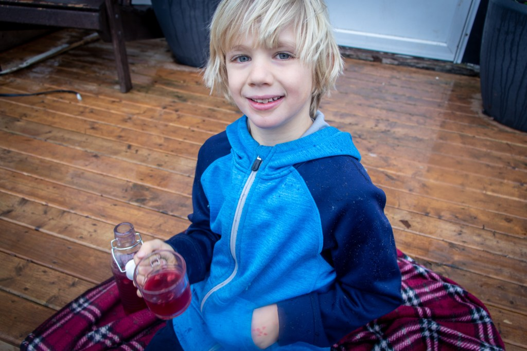 Boy enjoying a glass of water kefir
