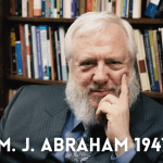 Image of William Abraham in a library.