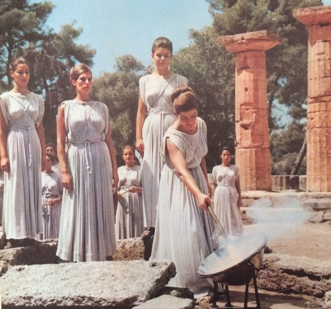 Chief Priestess, Aleca Katselli igniting the Sacred Olympic Flame at the Temple of Zeus, from the book,