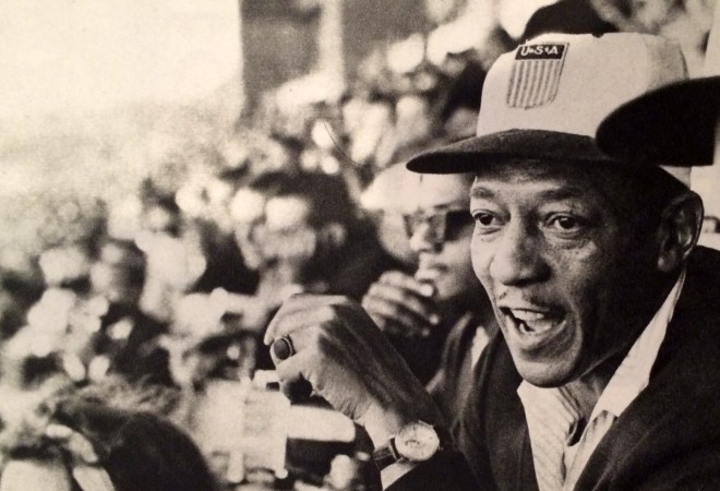 Jesse Owens at the Tokyo Olympics in 1964, from the book