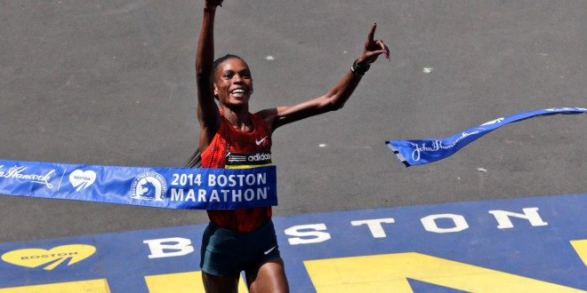 Rita Jeptoo, of Kenya, breaks the tape to win the women's division of the 118th Boston Marathon Monday, April 21, 2014 in Boston. She Marathons, tested positive for a banned substance in September 2014 and was banned for two years in January.  (AP Photo/Charles Krupa)