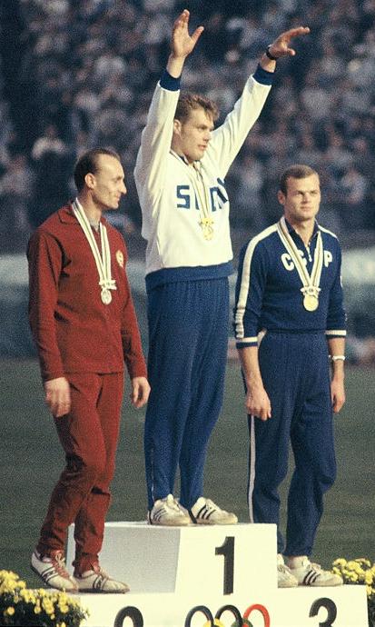 Gergely_Kulcsár,_Pauli_Nevala,_Jānis_Lūsis_1964 on medal stand (color)