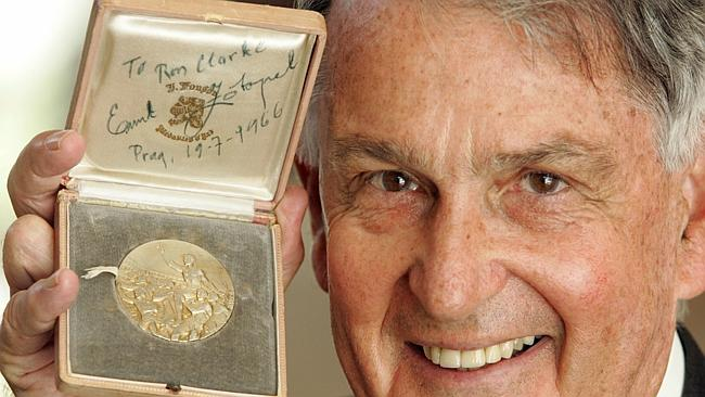 ron-clarke-and-his-medal-from-emil-zatopek