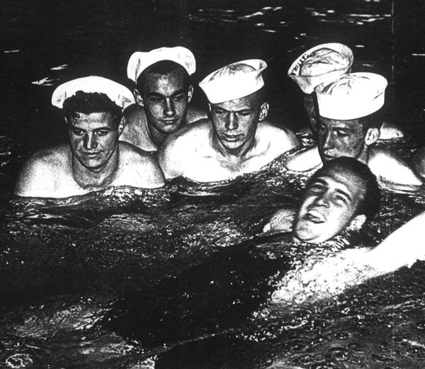 Adolph Kiefer center in the pool with naval personnel