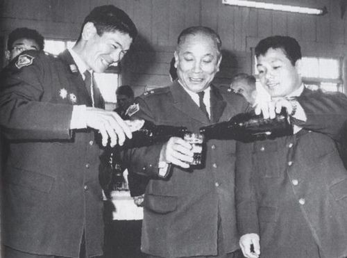Tsuburaya and Miyake celebrating