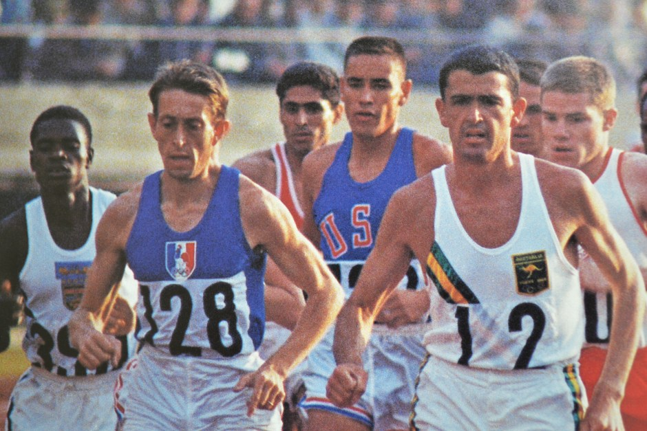 Billy Mills and Ron Clarke in 10000 meter run_The Olympic Century - XVIII Olympiad - Volume 16