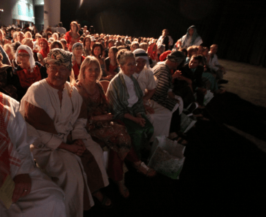 Audience Enjoying the One Gift Premiere