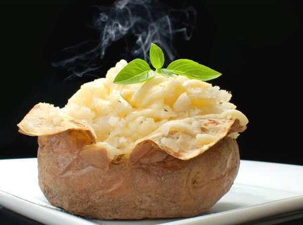 jacket potato with cheese cooling on kitchen counter