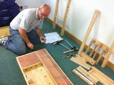 man-doing-woodworking-project