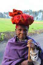 Grandmother carrying parcel on her head