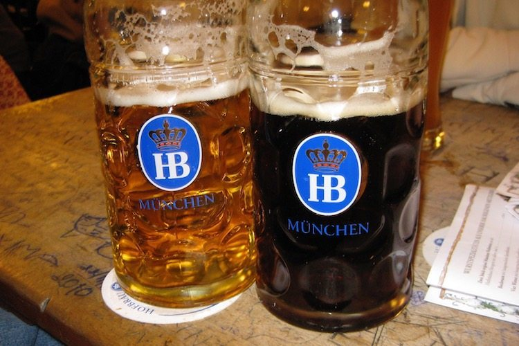 Steins of beer on a table in a Munich beer hall