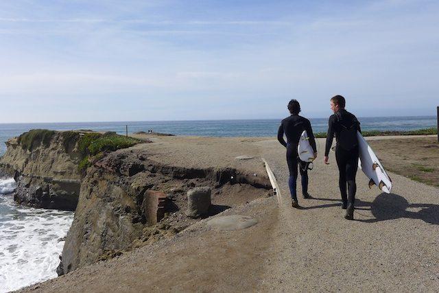 two men surfboards santacruz beach