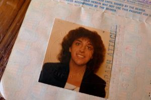 My first passport photo - starry-eyed, tan, and young.