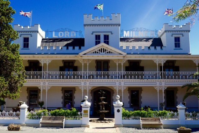 exterior of the lord milner hotel seen during luxury train travel and described in rovos rail review