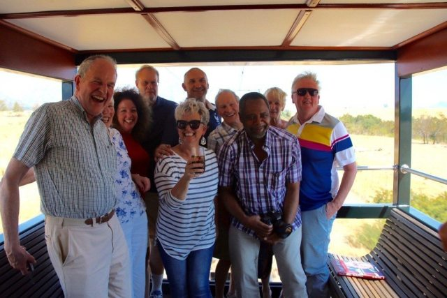 adults in caboose during luxury train travel described in rovos rail review