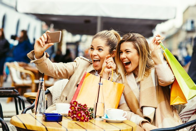 Women shopping and smiling thanks to DOSH cash back app.