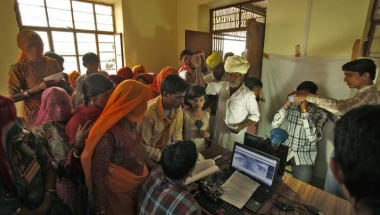 Villagers crowd inside an enrolment centre for UID database system at Merta district in Rajasthan