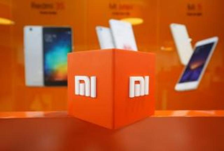 The logo of Xiaomi is seen inside the company's office in Bengaluru