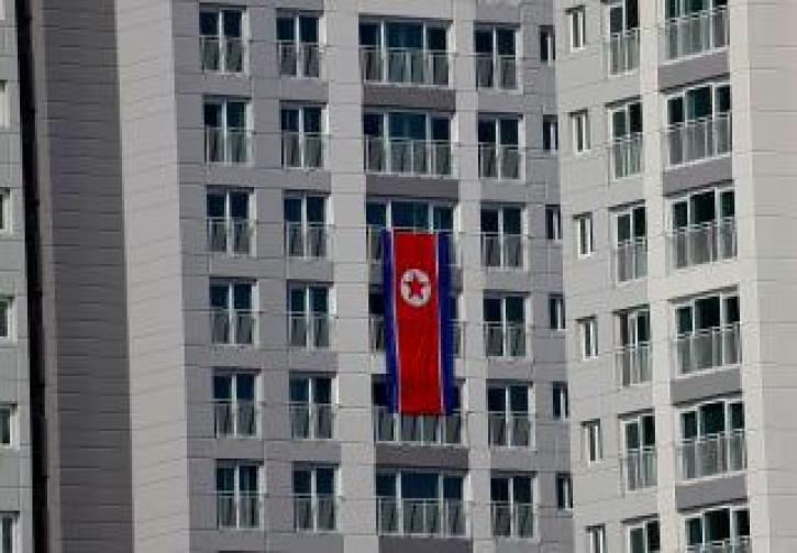 North Korean flag is seen hanging on a building at the Winter Olympics athletes village in Gangneung