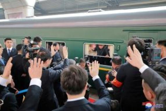FILE PHOTO: North Korean leader Kim Jong Un waves from a train as he paid an unofficial visit to China