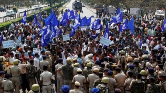 Police try to stop people belonging to the Dalit community as they take part in a protest during a nationwide strike called by Dalit organisations, in Chandigarh