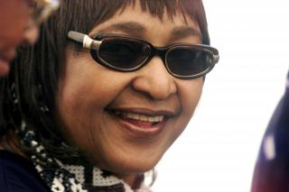 FILE PHOTO: Then ANC Womens League President Winnie Madikizela-Mandela smiles during the closing rally of the 51st National Conference of the ruling ANC in Stellenbosch