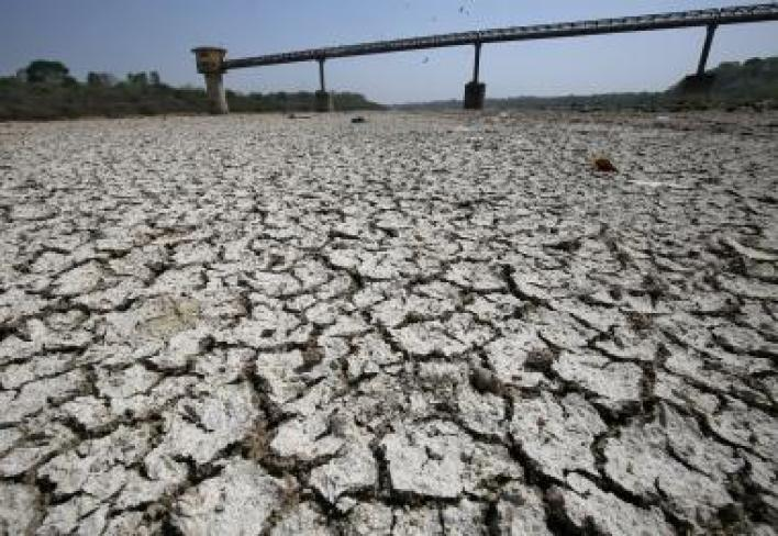 FILE PHOTO: A water pump shed is seen in the dried-up portion of the Sabarmati river on a hot day on the outskirts of Ahmedabad