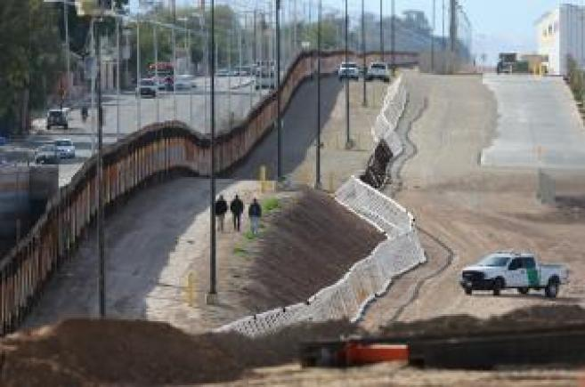Three men from India jump the fence from Mexico and give themselves up to U.S. border patrol agents in Calexico, California