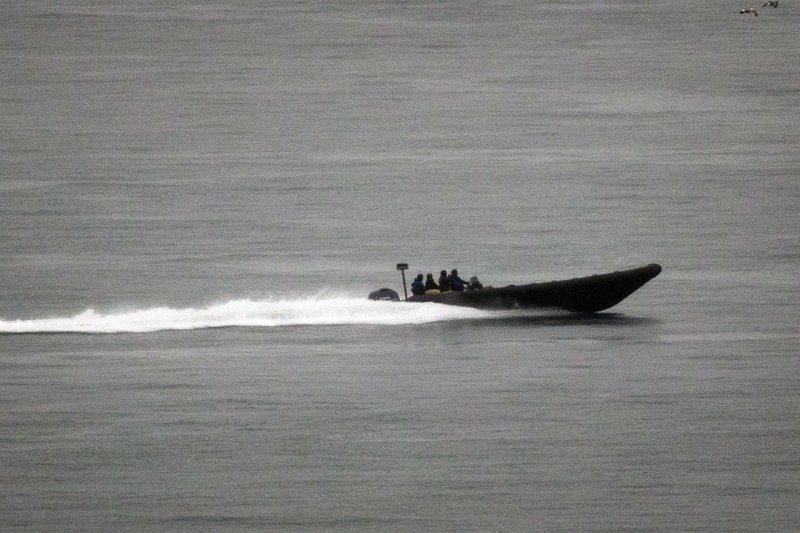 FILE - In this March 3, 2018 file photo, a speedboat with boxes of alleged drug cargo onboard speeds along the coast of La Linea de la Conception, in Cadiz province, south of Spain-AP