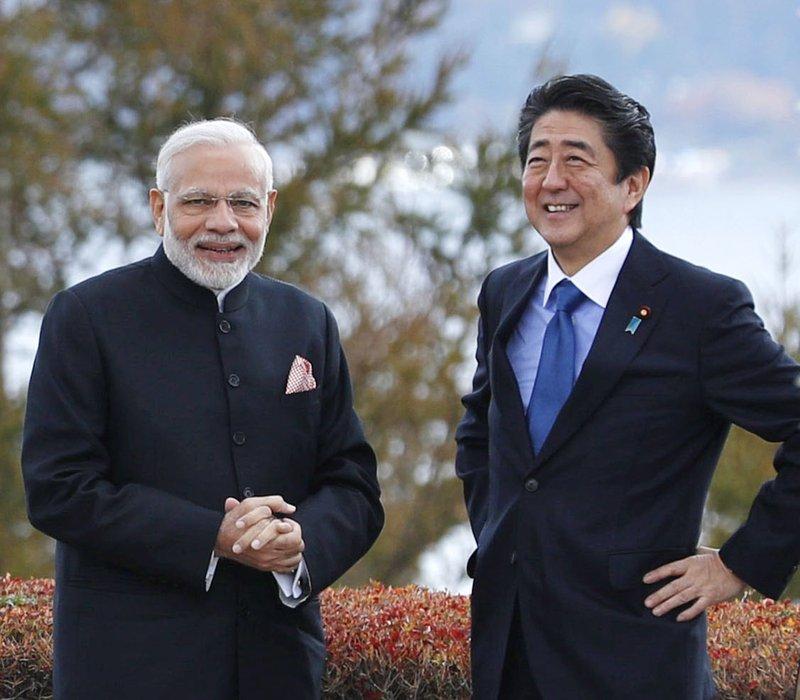 India's Prime Minister Narender Modi and Japan's Prime Minister Shinzo Abe at Hotel Garden in Yamanakako village-AP