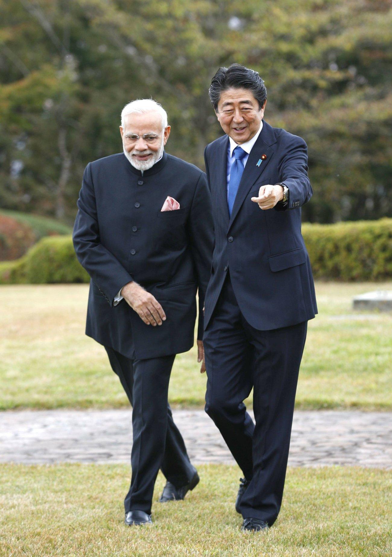 India's Prime Minister Narender Modi and Japan's Prime Minister Shinzo Abe together at Hotel garden, Yamanakako village-AP