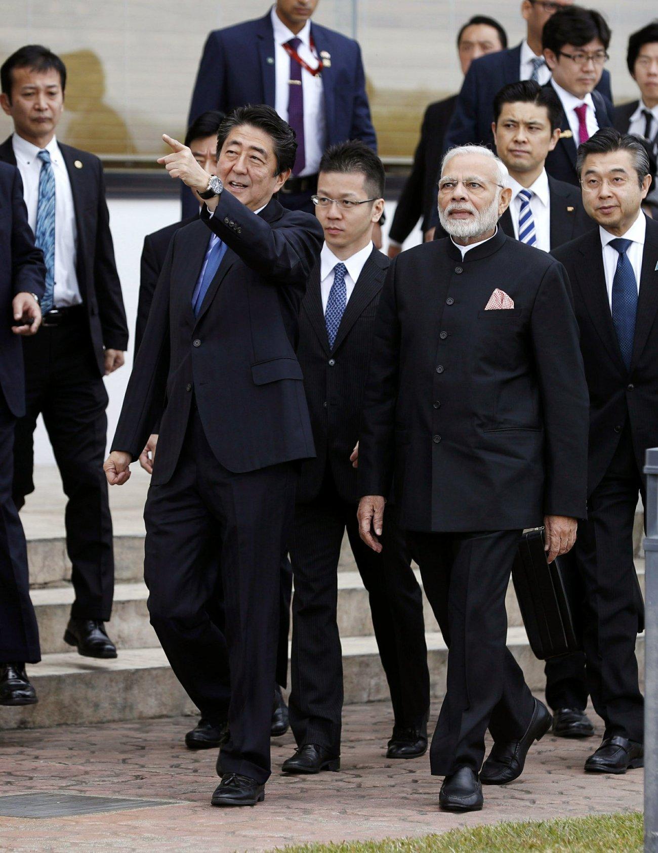 India's Prime Minister Narender Modi and Japan's Prime Minister Shinzo Abe walk together at Hotel Garden in Yamanakako village-AP