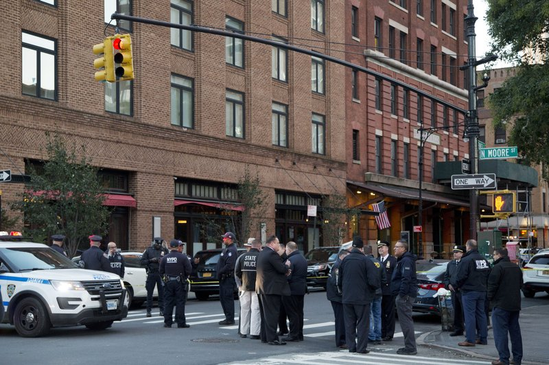 police stand watch near a building in New York after suspicious package on Oct. 25, 2018-AP