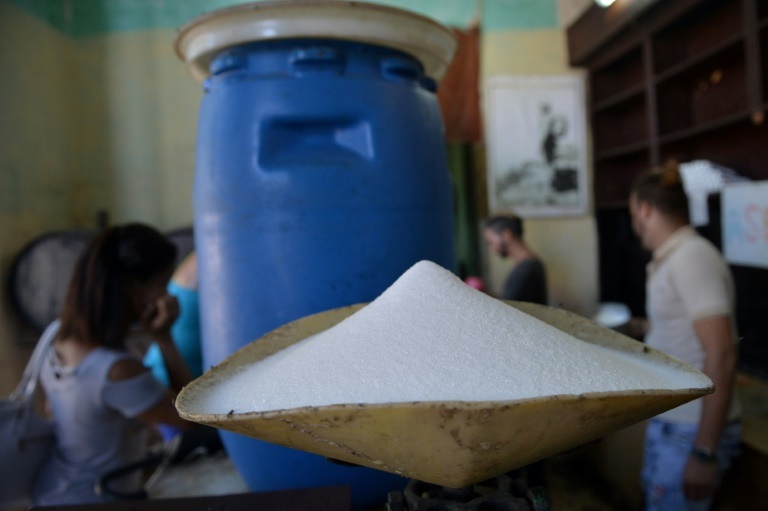 ugar produced in France is weighed at a grocery store in Havana -- Cuba-afp