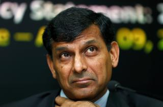 Rajan listens to questions during a news conference at the RBI headquarters in Mumbai