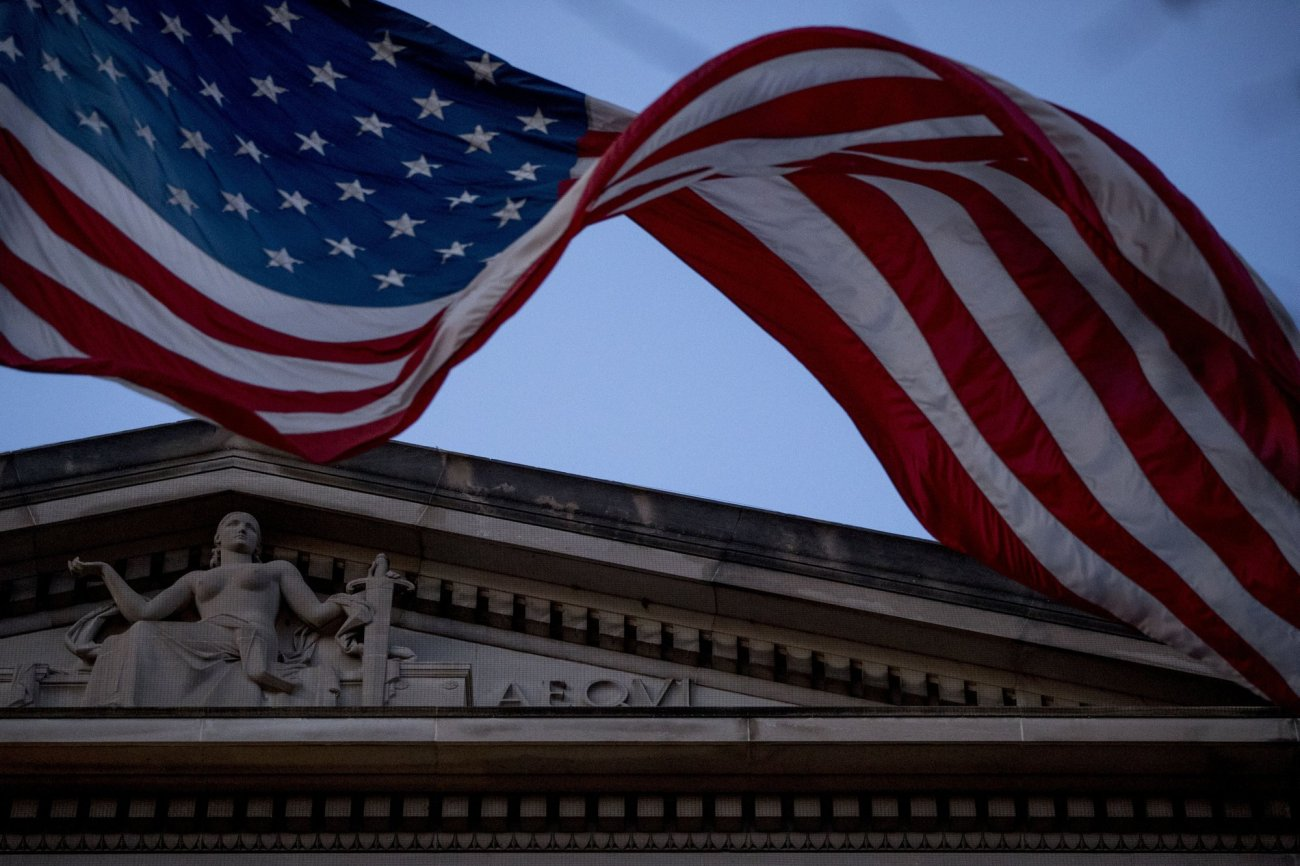 An American flag flies outside the Department of Justice in Washington