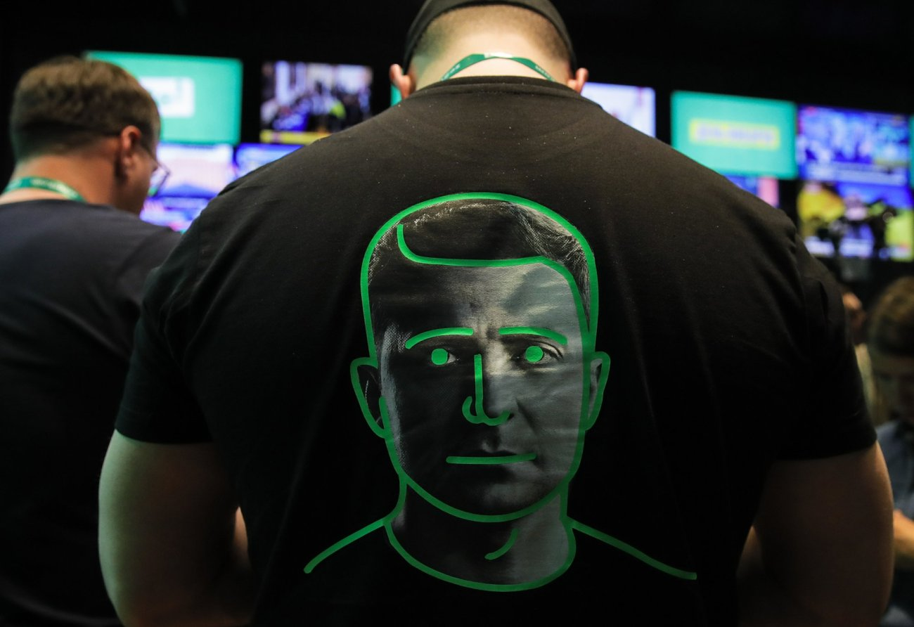 A man dressed in a shirt with a portrait of Ukrainian comedian and presidential candidate Volodymyr Zelenskiy-AP