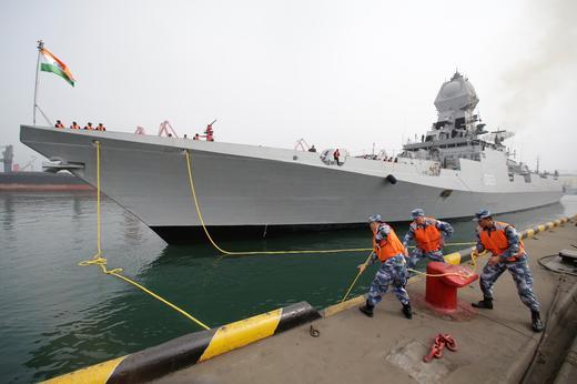 Chinese navy personnel moor the Indian Navy warship INS Kolkata at Qingdao Port -REUTERS