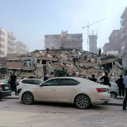 People-work-on-a-collapsed-building-in-Izmir-Turkey-Friday-Oct.-30-2020-after-a-strong-earthquake-in-the-Aegean-Sea-has-shaken-Turkey-and-Greece-AP