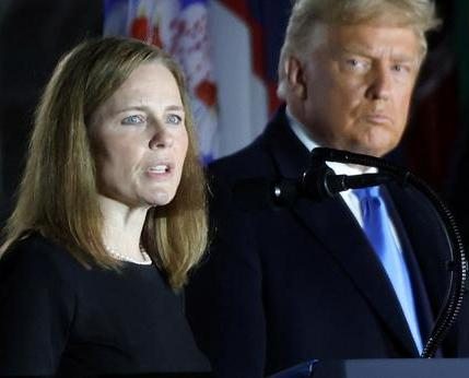 U.S.-President-Donald-Trump-looks-on-as-Judge-Amy-Coney-Barrett-delivers-remarks-after-she-was-sworn-in-as-an-associate-justice-REUTERS