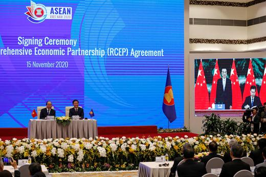 Vietnams-Prime-Minister-Nguyen-Xuan-Phuc-L-sits-next-to-Minister-of-Industry-and-Trade-Tran-Tuan-Anh-as-they-watch-a-screen-REUTERS