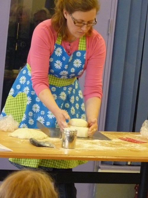 This is me, doing what I love, at a loaf shaping demonstration.