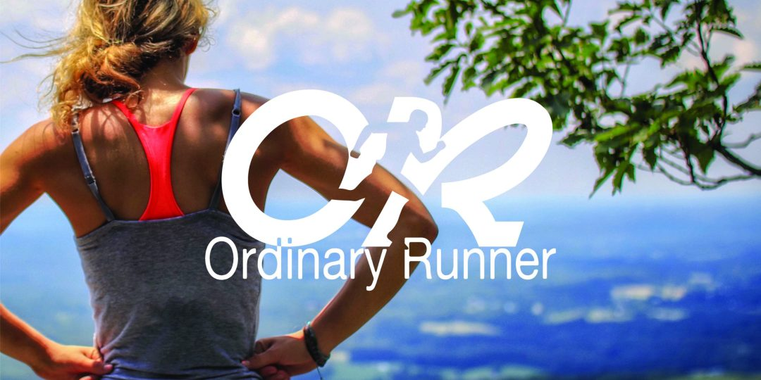 Header image - woman in exercise clothes looking over some hills with the ordinary runner logo on top