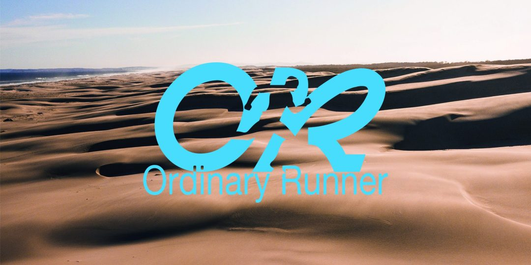 Desert with the Ordinary Runner logo overlaid