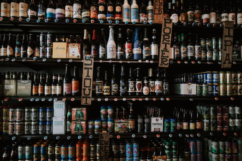 Shelves filled with beer in an off licence