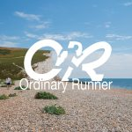Cliff next to the sea overlaid by the ordinary runner logo