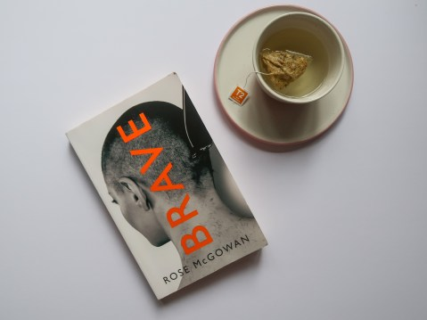 The book Brave by Rose McGowan next cup of tea on a white saucer