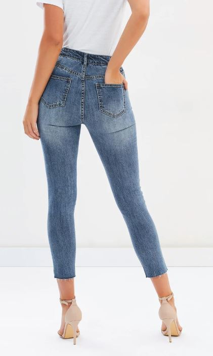 Female wearing denim jeans. Only bottom of her body shown in the picture.