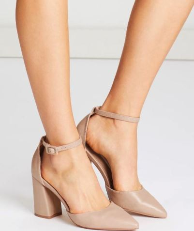Nude heels on female model. Only calf and foot shown.